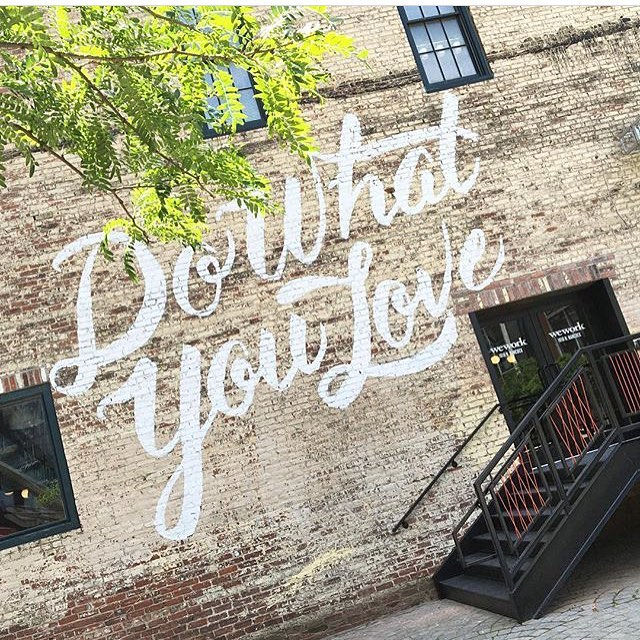 "WeWork Instagram account showing wall graffiti 'Do What You Love'"" title=""we-work-instagram-1.png"" caption=""false"