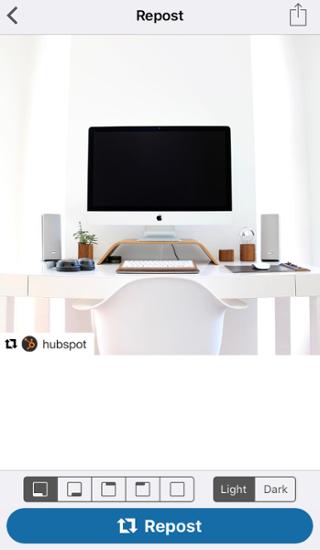 Foto de la computadora en la aplicación Repost for Instagram con botón azul para volver a publicar la foto